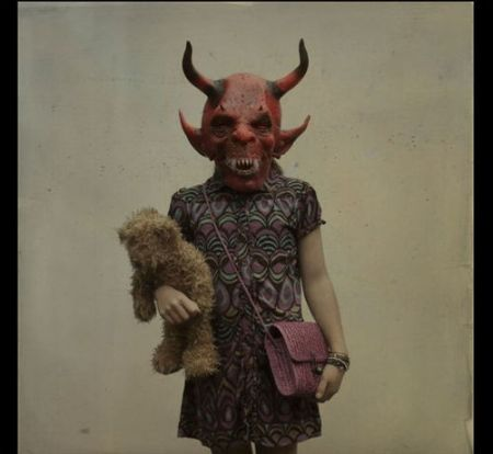 devil mask on girl